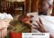 A screenshot showing Danny Mugarura and Dominic Kotarski sitting on a couch in the lobby of Kampala Serena Hotel