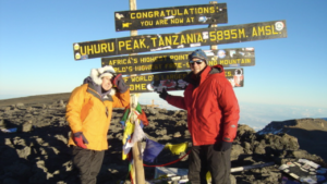 picture of Dominic and Christina at the top of Mount Kilimanjaro